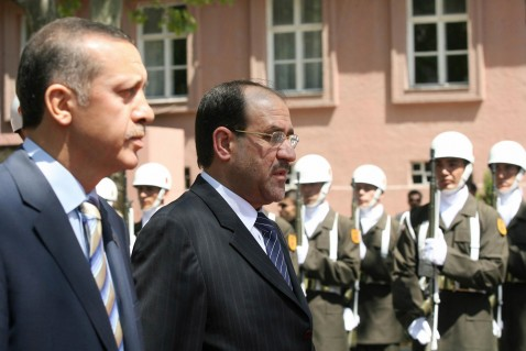 Turkish Prime Minister Recep Tayyip Erdogan walks with his Iraqi counterpart Nuri al-Maliki in a ceremony in Ankara 07 August 2007.
