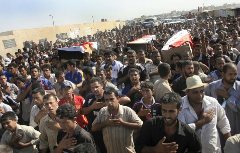 Iraqis chant slogans as they carry coffins of their relatives killed during a US military air strike in the predominantly Shiite Baghdad suburb of Sadr City, 08 August 2007.