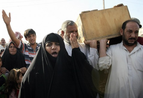 Iraqi mourners attend the funeral of a relative killed during a US military air strike in the predominantly Shiite Baghdad suburb of Sadr City, 08 August 2007.