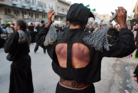 An Iraqi Shiite Muslim flagellates himself during a major religious festival in the Kadhimiyah district of Baghdad, 08 August 2007.