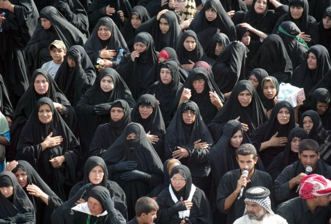Iraqi Shiite worshippers women chant as they walk towards the Kadhimiyah district of Baghdad to pay homage to the revered Imam Musa Kadhim at his shrine, 09 August 2007.