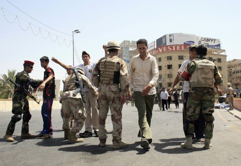 Iraqi soldiers search Shiite worshippers on their way to the Kadhimiyah district of Baghdad to pay homage at the shrine of the revered Imam Musa Kadhim, 09 August 2007.