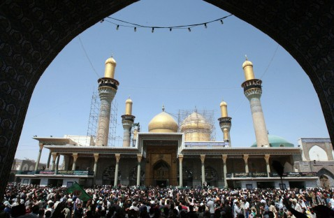 Iraqi Shiite worshippers gather to pay homage at the shrine of the revered Imam Musa Kadhim in the Kadhimiyah district of Baghdad, 09 August 2007.