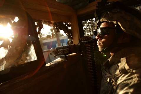 BAGHDAD, IRAQ - AUGUST 11: Spec. Rafael Mendez of Providence, Rhode Island, a member of the U.S. Army 82nd Airborne, mans a lookout on a combat outpost base August 11, 2007 in Baghdad, Iraq.