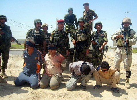 Iraqi soldiers guard blindfolded suspects in the restive city of Baquba, 60 kms (35 miles) north of Baghdad, 12 August 2007. Four suspected insurgents were arrested during a raid in a village in Baquba. Iraqi and US forces are conducting a major military