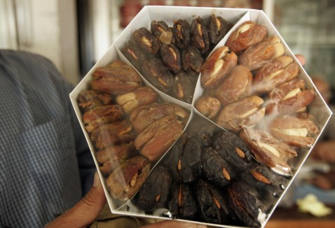 An Iraqi salesman displays a box of dates at a shop in Baghdad, 15 August 2007.