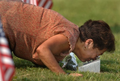 FORT STEWART, GA - AUGUST 16: Sara Salazar kisses the granite marker that serves as a memorial for her grandson, U.S. Army Pfc. Bruce Salazar, Jr. of Modesto California, during a memorial service August 16, 2007 on Warrior's Walk in Fort Stewart, Georgia.