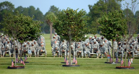 FORT STEWART, GA - AUGUST 16: Soldiers with the Army's 3rd Infantry Division wait for a memorial service to begin August 16, 2007 behind a section of eastern red bud trees on Warrior's Walk in Fort Stewart, Georgia.