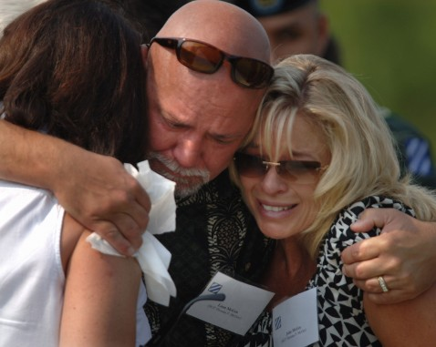 FORT STEWART, GA - AUGUST 16: Leon McGee (C) hugs his sister Julie McGee (R) and Sylvia McGee as he grieves for U.S. Army Sgt. Thomas McGee during a memorial service August 16, 2007 on Warrior's Walk in Fort Stewart, Georgia.