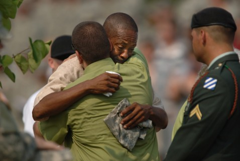 FORT STEWART, GA - AUGUST 16: Rhyan Stinson of Fullerton, California, is hugged by Michael Moody, Sr. as they grieve for their family members during a memorial service August 16, 2007 on Warrior's Walk in Fort Stewart, Georgia.