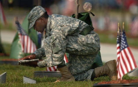 FORT STEWART, GA - AUGUST 16: An honor guard removes the cover from the stone marker for U.S. Army Spc. Carter Gamble of Columbus, Georgia, during a memorial service August 16, 2007 on Warrior's Walk in Fort Stewart, Georgia.