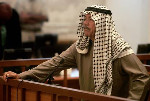 Ali Hassan al-Majid known as 'Chemical Ali' stands in court as he listens to the verdict being pronounced by Chief Judge Mohammed al-Oreibi al-Khalifah (not pictured) during his trial in Baghdad, 24 June 2007.