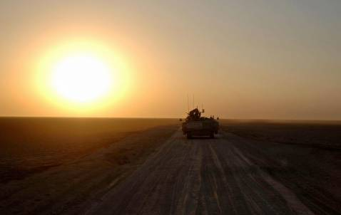 A handout photograph from Britain's Ministry of Defence, shows a British armoured vehicle on patrol in southern Iraq, 03 September 2007.