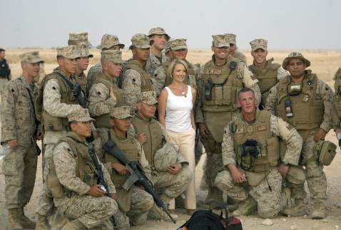 Newly-appointed White House Press Secretary Dana Perino poses with US Marines.