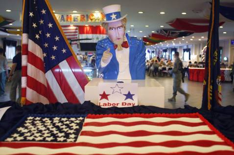 BAGHDAD, IRAQ - SEPTEMBER 3: 'Uncle Sam' stands over an American flag cake at the U.S. embassy dining hall in the Green Zone September 3, 2007 in Baghdad, Iraq.