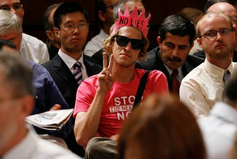 WASHINGTON - SEPTEMBER 11: A protester gestures while listening to testimony from Gen. David Petraeus and U.S. Ambassador to Iraq Ryan Crocker during a hearing of the Senate Foreign Relations on Capitol Hill September 11, 2007 in Washington, DC.