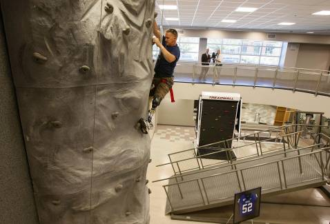 WASHINGTON - SEPTEMBER 12: Sgt. 1st Class Jacque Keeslar of Great Bear Lake, California, who was injured by an IED in Iraq in June 2006, uses a climbing wall at the newly completed Military Advanced Training Center at Walter Reed Army Medical Center.