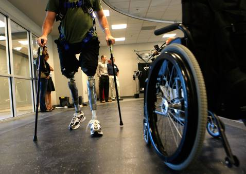 WASHINGTON - SEPTEMBER 12: Marine LCpl Joshua Bleill of 1/24 4th Marine Division, who was injured in October 2006 in Fallujah, Iraq, walks with prosthetic limbs at the newly completed Military Advanced Training Center at Walter Reed Army Medical Center.