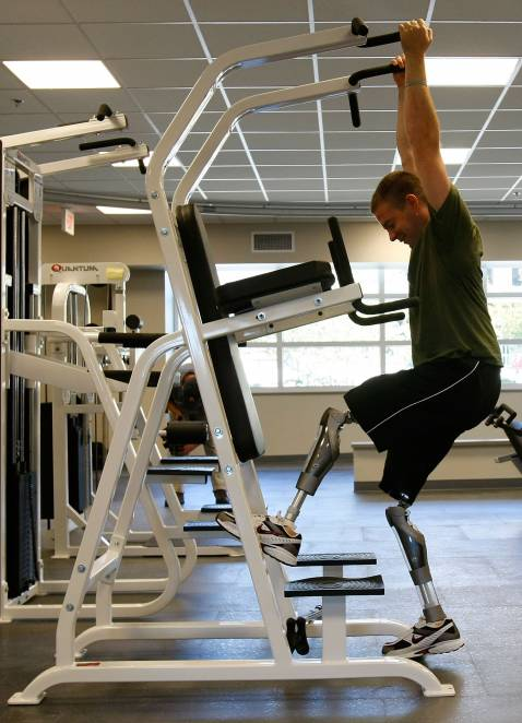 WASHINGTON - SEPTEMBER 12: Marine LCpl Joshua Bleill of 1/24 4th Marine Division, who was injured in October 2006 in Fallujah, Iraq, exercises with gym equipment at the newly completed Military Advanced Training Center at Walter Reed Army Medical Center.