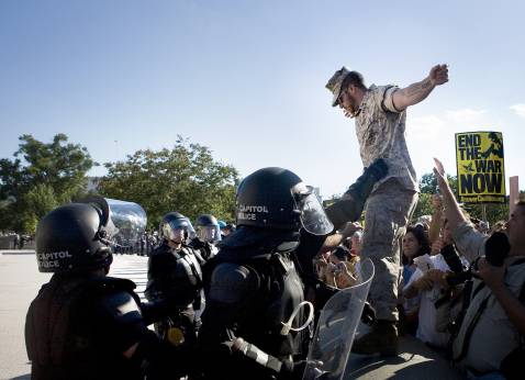 Adam Kokesh of the Iraq Veterans Against the War (IVAW) becomes the first to step across the police barricades in an organized show of protest against the war.