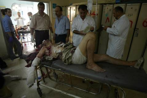 Iraqi medics treat a wounded Shiite from the Turkmen minority, at a Kirkuk hospital, 16 September 2007.