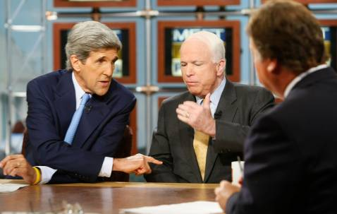WASHINGTON - SEPTEMBER 16:Former U.S. presidential candidate Sen. John Kerry (D-MA) (L) debates with Republican presidential hopeful Sen. John McCain (R-AZ) (C) as moderator Tim Russert (R) looks on during a taping of Meet the Press September 16, 2007 in Washington, DC.