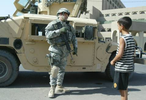 US soldier talks to Iraqi boy during patrol in Baghdad on Sept. 20.