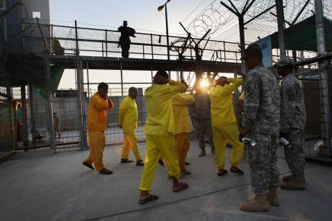 BAGHDAD, IRAQ - SEPTEMBER 20: Iraqi detainees are moved by U.S. Army guards through the Camp Cropper detention center September 20, 2007 in Baghdad, Iraq.