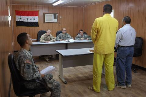 BAGHDAD, IRAQ - SEPTEMBER 20: A U.S. military review committee conducts a hearing of the case of an Iraqi detainee at the Camp Cropper detention center September 20, 2007 in Baghdad, Iraq.