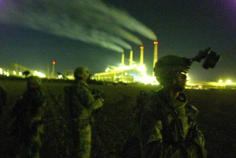 US soldiers equipped with nigh-vision goggles wait for an airlift at a Forward Operating Base (FOB) as they prepare to raid an al-Qaeda hideout near Iskandaria south of Baghdad early 21 September 2007.