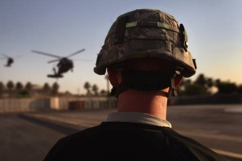 BAGHDAD, IRAQ - SEPTEMBER 22: A U.S. Army medic from the 28th Combat Support Hospital awaits helicopter ambublances carrying American wounded September 22, 2007 in Baghdad, Iraq.