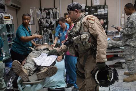 BAGHDAD, IRAQ - SEPTEMBER 22: A U.S. Army helicopter medic leaves documentation atop a wounded American soldier flown to the 28th Combat Support Hospital September 22, 2007 in Baghdad, Iraq.