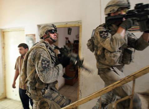 US Army soldiers of Alpha Company, 1/38 Infantry Regiment, search a house during a mopping-up operation to search and secure the area, in Baquba, some 50 kms north-east of Baghdad, 27 September 2007.aghdad, 27 September 2007.