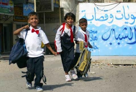 An Iraqi girl and her two brothers leave their school after attending the first day of classes, 30 September 2007 in Baghdad.