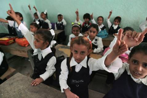 Iraqi school girls attend the first day of classes, 30 September 2007 in Baghdad.