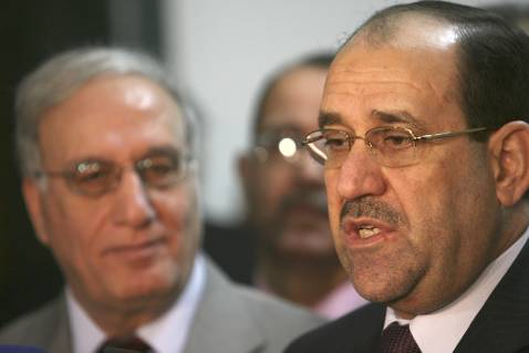 Iraq's Prime Minister Nuri Al-Maliki (R) speaks as Defense Minister Abdul-Qadir al-'Ubeidi looks on during a press conference on October 3 in Baghdad