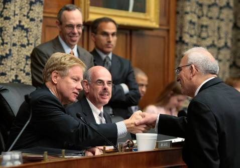 WASHINGTON - OCTOBER 04: Judge Radhi Hamza al-Radhi (R), former Commissioner of Public Integrity in Iraq, shakes hands with ranking member Rep. Tom Davis (R-VA) (L) as committee Chairman Rep. Henry Waxman (D-CA) (C) looks on prior to hearing.