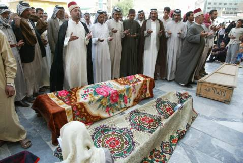 Najaf, Oct. 17: Mourners pray over bodies of policemen killed in an IED attack. Seven policemen were killed in Tuesday's blast on the road between Diwaniya and the town of Afak.