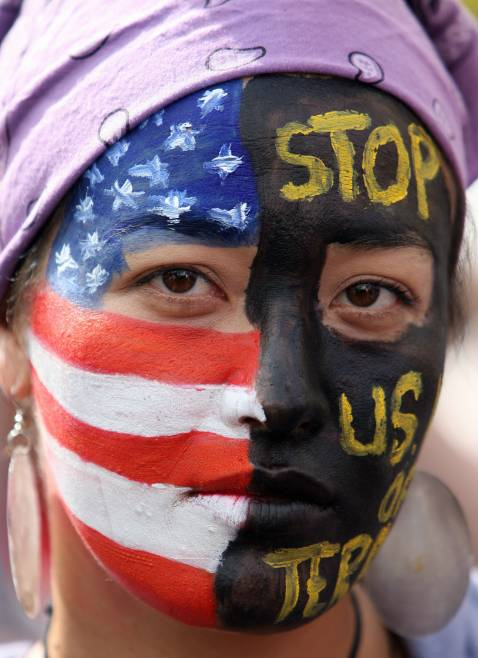 A demonstrator marches against the Iraq war 27 October 2007 in Los Angeles, California. Anti-war protestors gathered in 11 cities across the US to rally.