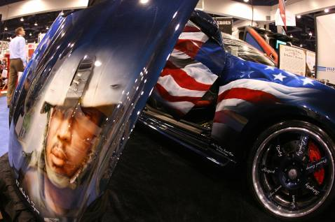 A costum car with a painting in tribute to fallen US soldiers in Iraq is shown at the SEMA show in Las Vegas, Nevada, 30 October 2007.