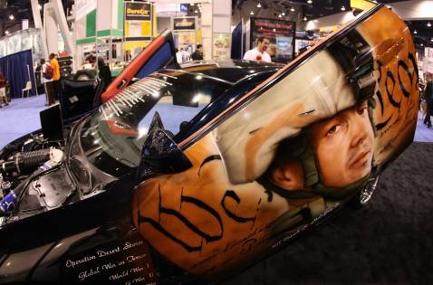 A costume car with a painting in tribute to fallen US soldiers in Iraq is shown at the SEMA show in Las Vegas, Nevada, 30 October 2007.