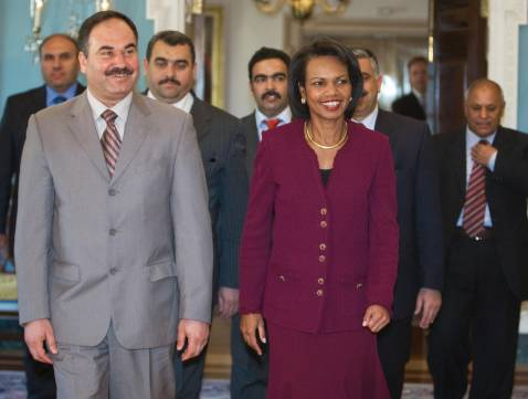 US Secretary of State Condoleezza Rice(C) walks with the Minister of State for Foreign Affairs Rafe Al Essawi(L) and other members of the delegation from Al Anbar Province, Iraq, at the US State Department in Washington 01 November 2007.