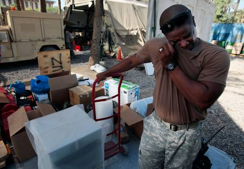 BAGHDAD, IRAQ - NOVEMBER 05: Staff Sgt. Ibrahim Coulibali,originally from Ivory Coast but now living in Maryland, wipes sweat as he packs up the last of the equipment for Task Force Justice November 5, 2007 in Forward Operating Base Justice in Baghdad, Ir