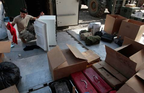 BAGHDAD, IRAQ - NOVEMBER 05: Spc. Jose Cruz from Texas cleans up some equipment for Task Force Justice before loading it to leave November 5, 2007 in Forward Operating Base Justice in Baghdad, Iraq.