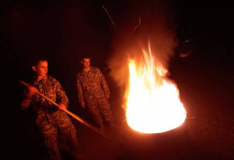 BAGHDAD, IRAQ - NOVEMBER 05: Soldiers of Task Force Justice burn unusable equipment in the early morning hours of November 5, 2007 in Forward Operating Base Justice in Baghdad, Iraq.
