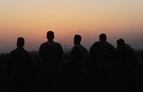 BAGHDAD, IRAQ - NOVEMBER 05: Soldiers of Task Force Justice look out onto the historic Khadamiyah mosque just before an end-of-tour awards ceremony November 5, 2007 at Forward Operating Base Justice in Baghdad, Iraq.