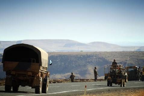 A convoy of Turkish army drives towards Mount Kupeli near the Turkey-Iraq border in the province of Sirnak, southeast Turkey, 14 November 2007.