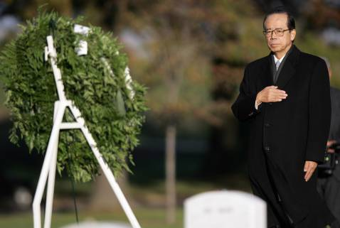 Japanese Prime Minister Yasuo Fukuda lays a wreath in Section 60, where the graves of war dead in Iraq and Afghanistan are located 16 November, 2007 at Arlington National Cemetery in Arlington, Virginia.