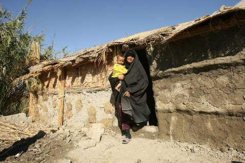 An Iraqi woman walks out of her hut in the marshes area near the southern city of Nasiriyah, 25 November 2007.
