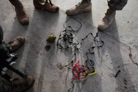 DIYALA PROVINCE, IRAQ - DECEMBER 03: U.S. soldiers in the 4th Stryker Brigade, 2nd Infantry out of Ft. Lewis, Washington, look over a strand of 'crush wire' attached to a blasting cap often used for roadside bombs December 3, 2007 in Mukhisa, Iraq.
